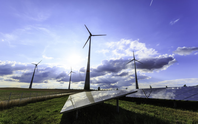 wind turbines and modern solar panels in the country side